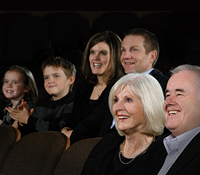 Family in audience enjoying a performance