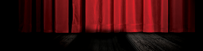 red theatre curtain on black stage