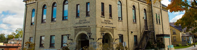 Front exterior of the Drayton Festival Theatre, beige brick opera house