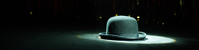 bowler hat in spotlight on stage