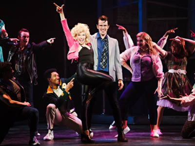 Chelsea Preston as Sandy, David Cotton as Danny, and Company in Grease, Drayton Entertainment, 2019 Season